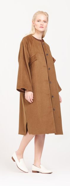 The camel coat is a must-have for any fashionista. This collarless camel coat is designed in an oversized style with wide raglan sleeves, chest pocket flaps and overlapping side vent details. http://www.paisie.com/collections/coats-jackets/products/oversized-camel-coat
