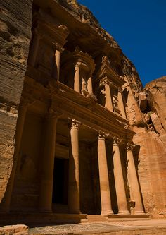 The Treasury (Al Khazneh) at Petra   is carved out from the sandstone cliff wall, it was probably a temple tomb.  Petra is in a valley and was founded by the Nabatean civilization, who carved buildings out of the red rock face. #Jordan #kitsakis