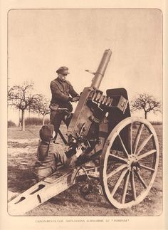 "Belgian soldiers with an automatic 37-mm cannon ""QF 1 pounder""."