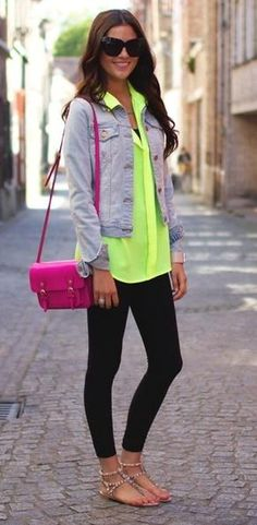 Neon chiffon top, jean jacket, black leggings, neon cross body bag, nude sandals, and oversized sunglasses.