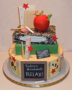 """A Cake for a Teacher - Bottom tier is 12"""" round covered in buttercream.  The books have fondant covers.  The apple was RKT covered in fondant and everything else was gum paste.  My favorite part was the chalkboard eraser - I loved how realistic it looked!"""