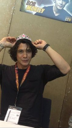 He's trying on the Princess' tiara!
