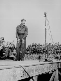 Danny Kaye, well known stage and screen star, entertains 4,000 5th Marine Div. occupation troops at Sasebo, Japan. The crude sign across the front of the stage says: `Officers keep out! Enlisted men's country.' Photograph by Pfc. H. J. Grimm, taken October 25, 1945.