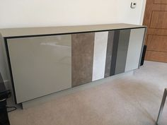 BOOK sideboard in matt glass frame with a combination of glass and ceramic striped fronts. BOOK range offers the modern look and many modules to choose from. Delivered to our client in Middlesex.