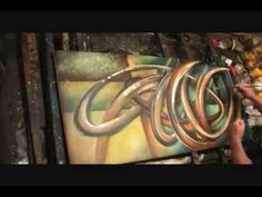 2 handed ABSTRACT PAINTING Demonstration Mix Lang art. He uses complementary colors, lights and darks, shape, and repetition masterfully to create a very interesting end product.