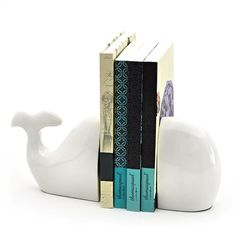 Summery bookends for the baby's bedroom! I will be decorating my baby's nursery this summer. I want it to be ready for when he/she gets home in December... I have a strong feeling it will be a sweet baby boy, and these whale bookends have just inspired me to create a nautical theme! Perfect for holding baby's memory books...  #indigo #perfectsummer
