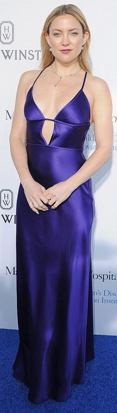 Who made  Kate Hudson's purple cut out gown, silver pumps, and jewelry? Dress – Amanda Wakeley