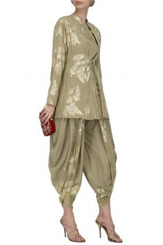 Nikasha Featuring a grey front tie-up peplum top in crepe base with gold palm leaf foil printing and embroidery. It is paired with panelled cowl dhoti pants. Dhoti Salwar Suits, Salwar Suits Pakistani, Salwar Kameez, Kids Suits, Suits For Women, Clothes For Women, Indian Designer Suits, African Fashion Designers, Fashion Pants