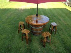 Wine Barrel Umbrella table set. $1,800.00, via Etsy.