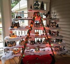 The porcelain versions of Christmas village decorations have become popular in recent times. Check these awesome DIY ideas of Christmas village decorations. Ladder Christmas Tree, Christmas Tree Village, Christmas Villages, Christmas Village Decorations, Victorian Christmas Decorations, Holiday Decor, Modern Christmas, Christmas Diy, Ladder Display