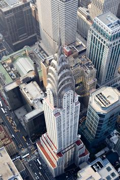 The Chrysler Building, an Art Deco style skyscraper in New York City, located on the east side of Manhattan in the Turtle Bay area at the intersection of 42nd Street and Lexington Avenue, 319 m from the ground, the 4th biggest building in NYC in 2013. Built for the Chrysler cars company.