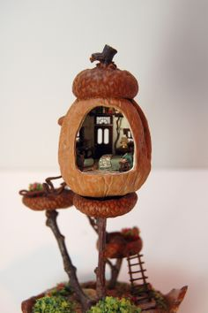 miniature house made from a walnut, acorn caps, oak twigs, etc. ... by Nell Corkin ... What fairy wouldn't want to move in?