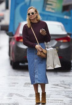Effortless: Diane, 38, looked stylish in a midi denim skirt and chunky maroon sweater with...