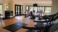 Enjoy the fully equipped gym at the Royal Livingstone. Livingstone, Conference Room, Gym, Table, Furniture, Home Decor, Decoration Home, Room Decor, Livingston