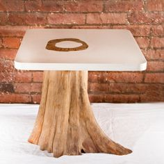 This is gorgeous - like a tree holding up your stuff.. Olga Guanabara is a company that makes furniture out of reclaimed wood and materials - gorgeous!!