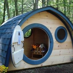 Price Just Reduced on this Hobbit Hole Playhouse with round front door and windows, all natural wood construction, blue trim