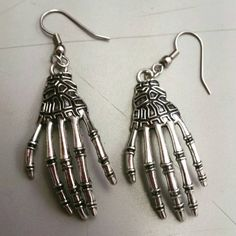 Check out this item in my Etsy shop https://www.etsy.com/listing/466714528/skeleton-hand-earrings-hand-earrings