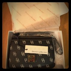 Dooney and Bourke wristlet. NWT Still in wrapping! Pristine Dooney and Bourke wristlet in the box, and the wrapping. NWT! Authentic and the perfect color combo. Dooney & Bourke Bags Clutches & Wristlets