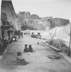 Children playing outside bomb shelters during WWII in Malta.