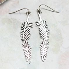 I LOVE feather earrings