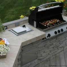 Ready to bring out the grill this spring or are you still thinking about an outdoor kitchen? | Grill Deck vs Outdoor Kitchen: Which Is Right For You? | archadeckwestcounty.com