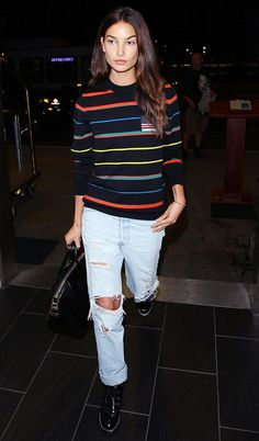 Lily Aldridge went playful with a striped sweater and ripped boyfriend jeans