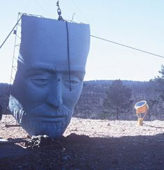 The face of the Christ of the Ozarks being lifted into place.