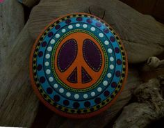 Hand Painted Peace Sign Rock by PeaceOnTheRocks on Etsy, $20.00