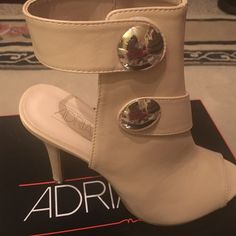 25% off 2+ 🎉 Peep toe boots Very pretty Bone color peep toe heels size 7.  Come with spare heel taps.    Very stylish.   Never worn. Adrianna New York  Shoes Heels