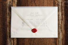 White Translucent Envelope with a bold Wax Seal.