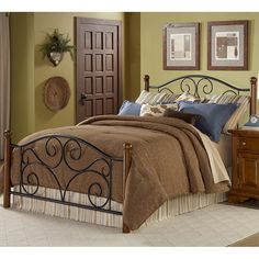 This steel and wood queen-size bed will add elegance and sophistication to any bedroom. The steel headboard and footboard features an intricate swirl motif detail on its curved headboard. Solid wood posts and steel bedframe make this bed durable....more