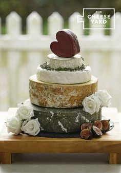 With a pretty vintage cheddar heart topping this lovely cheese cake of crumbly yarg, award winning stilton, soft ewe's and camembert all you guests will delight in this cheese cake.  Heather Wedding Cheese Tower by The Cheese Yard, Knutsford.  Delivery throughout the UK and overseas.
