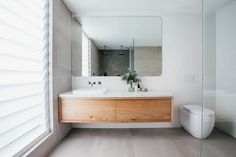 nice long bench space, like the one sink, would do inset mirror with storage