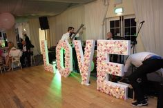 Flower wall light up LOVE letters set up with the band Function Room, Letter Set, Greggs, Love Letters, Flower Wall, Light Up, Wedding Venues, Wall Lights, Gift Wrapping