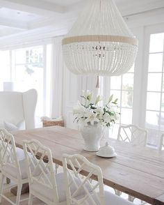 Jackson MS Top Picks Showrolake home Neutral Dining Room. Neutral Dining room with reclaimed wood table, white chairs and white beaded chandeliers. Home Interior, Interior Design, Interior Doors, Design Interiors, Kitchen Interior, Modern Interior, Modern Decor, Interior Decorating, Decorating Ideas