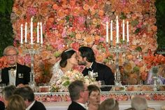 Royal wedding between Prince Carl-Philip and Princess Sofia of Sweden | Wall of flowers including 3 500 garden roses | Dress by Ida Sjöstedt