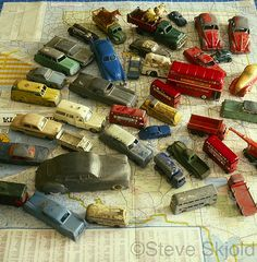 Antique toy cars on map by Spike's Shoes, via Flickr