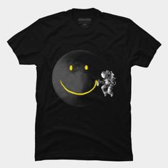 Astronaut spray painting a smiley face on the moon t-shirt.
