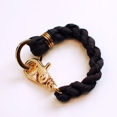 Silk twist bracelet with gold plated hardware, via Etsy