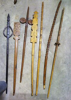 6 distaffs and a spindle