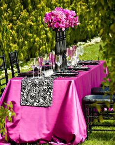 Gorgeous colors for an outdoor table setting...Black or hot pink napkins, garland, and table overlays as well as napkin rings, coasters, and wine covers available at alwayselegant.com