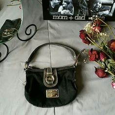 "GUESS SMALL BLACK BAG *IN EXCELLENT PRE-OWNED CONDITION *INTERIOR IS IN EXCELLENT CONDITION  *ZIP & FOLD OVER CLOSURE *1 INSIDE ZIP POCKET *LENGTH MEASURES APPROX 9"" *WIDTH MEASURES APPROX 2"" *HEIGHT MEASURES APPROX 12"" *STORED IN NON-SMOKING PET FREE HOME Guess Bags"