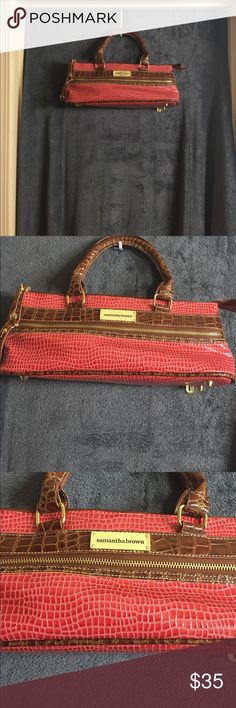 Wine purse This is the cutest little wine purse. It's red snake skin. It's lined inside to keep your wine cold. It comes with a cork screw. It has a zipper pocket in the front and on the bottom.  Never used. Samantha Brown Bags