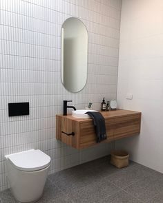 DIY bathroom decor and suggestions on a tight budget. Ideas for organization, storage, decorating, and renovations. Small Bathroom Tiles, Bathroom Tile Designs, Laundry In Bathroom, Bathroom Renos, Bathroom Interior Design, Bathroom Flooring, Small Bathrooms, Toilet Tiles Design, Downstairs Toilet