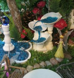 Water.  Fish tank rock. Fairy garden