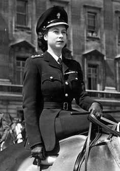 Princess Elizabeth sits side-saddle in her uniform as colonel-in-chief of the Grenadier Guards in this 1947 photo.