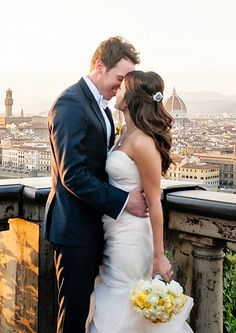 Isa and Paul share a kiss against the backdrop of the Florence skyline.