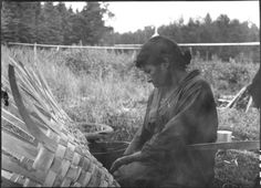 Algonquin woman weaving an Ash Splint Basket - 1929