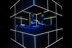 corner dj booth....... Always liked this idea for a club set up with a side door entry