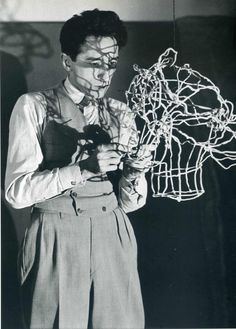 Jean Cocteau sculpting his head in wire, 1920s. Photo: Man Ray.